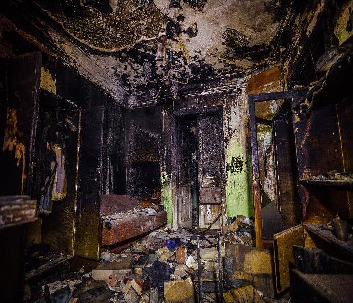 Burned furniture and charred walls in black soot