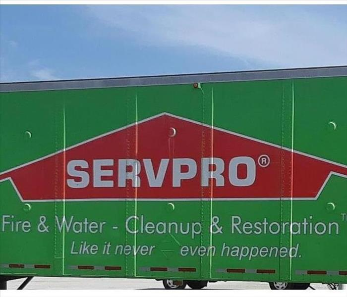 The side of a green SERVPRO 18 wheeler.